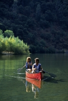 Canoeing Lake Clementine, Auburn, California  Couple canoeing on Lake Clementine