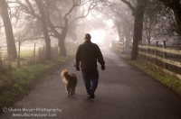 Rural Auburn, California Man walking his dog down a foggy country road, Auburn California