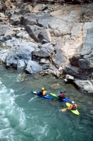 Kayaking the American River, California Kayakers eddying out at Yankee Jim's, on the north fork of the American River, near Colfax and Weimar, California