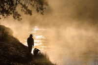 D-OL-03-02 Man and his dog enjoying the Deschutes River, La Pine State Park, Oregon