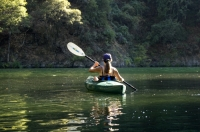 Woman kayaking Lake Clementine, Auburn, California Woman kayaking Lake Clementine, Auburn, California