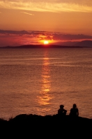 Children watching the sunset from San Juan Island, Washington Children enjoying the sunset at San Juan County Park, Washington